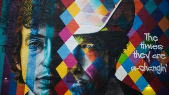 A mural of songwriter Bob Dylan by Brazilian artist Eduardo Kobra is on display in downtown Minneapolis, Minnesota on October 15, 2016. On October 13, 2016, Dylan was awarded the Nobel Prize in Literature. Dylan is the second Nobel laureate in literature from Minnesota after Sinclair Lewis, whose biting satire of Midwestern life and the race to materialism won him the prize in 1930, a first by an American. Dylan's Nobel comes months after Minnesota's other musical luminary -- Prince, who proudly associated himself with the Minneapolis area -- died of an accidental painkiller overdose.  / AFP / STEPHEN MATUREN / TO GO WITH AFP STORY by Shaun TANDON, 'For Dylan, aura of mystery extends to hometown' RESTRICTED TO EDITORIAL USE - MANDATORY MENTION OF THE ARTIST UPON PUBLICATION - TO ILLUSTRATE THE EVENT AS SPECIFIED IN THE CAPTION        (Photo credit should read STEPHEN MATUREN/AFP/Getty Images)