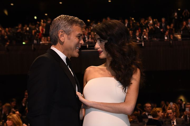 Amal and George Clooney look just as smitten four years later.