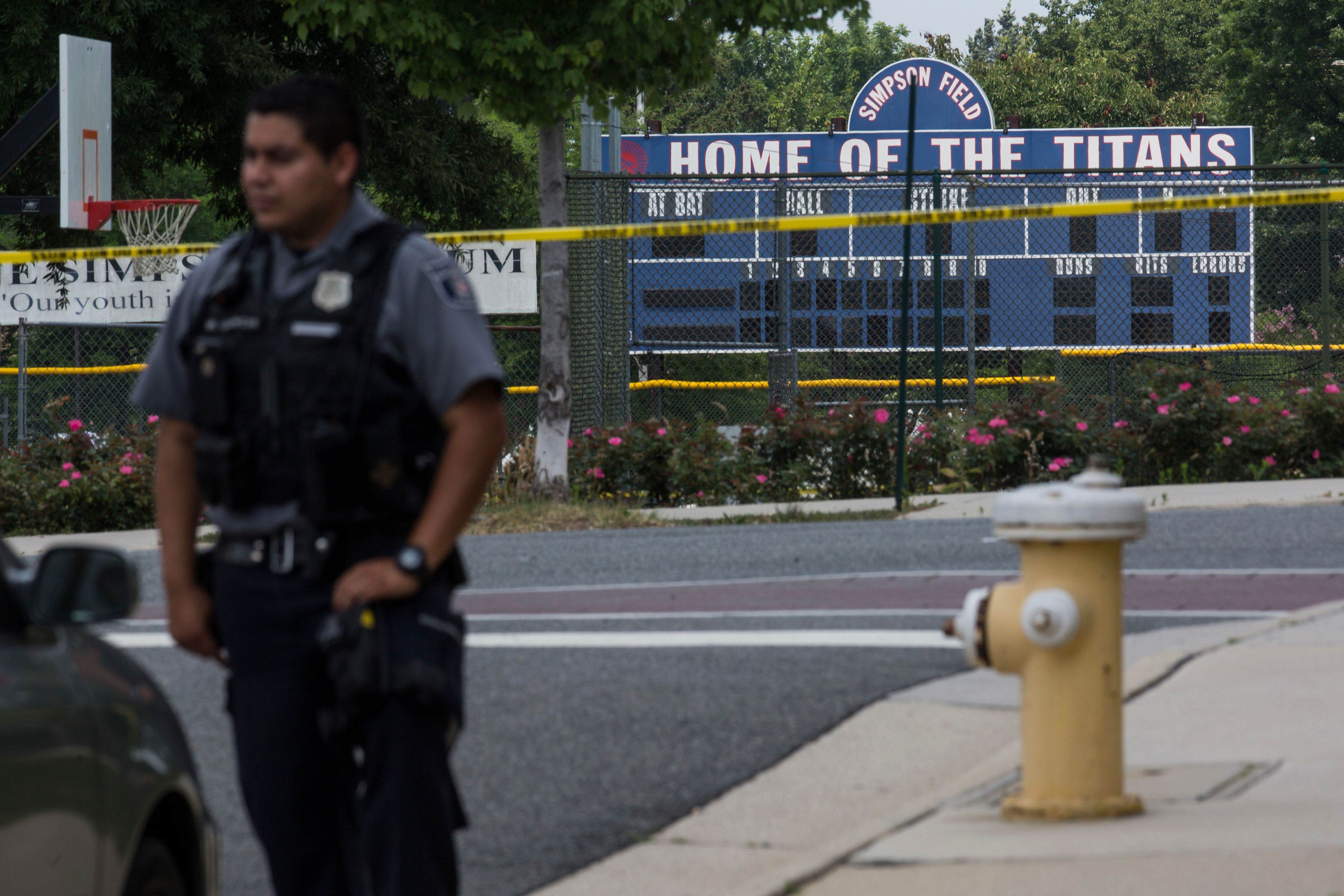 ALEXANDRIA, VA - JUNE 14: A police officer stands near Eugene Simpson Field, the site where a gunman opened fire June 14, 2017 in Alexandria, Virginia. Multiple injuries were reported from the instance, the site where a congressional baseball team was holding an early morning practice, including House Republican Whip Steve Scalise (R-LA) who was reportedly shot in the hip. (Photo by Zach Gibson/Getty Images)