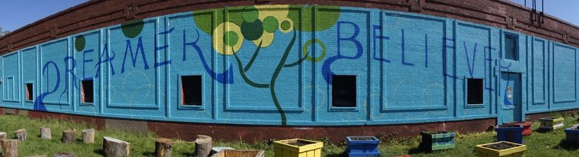 The mural painted by students on the side of KIPP Bloom Middle School.