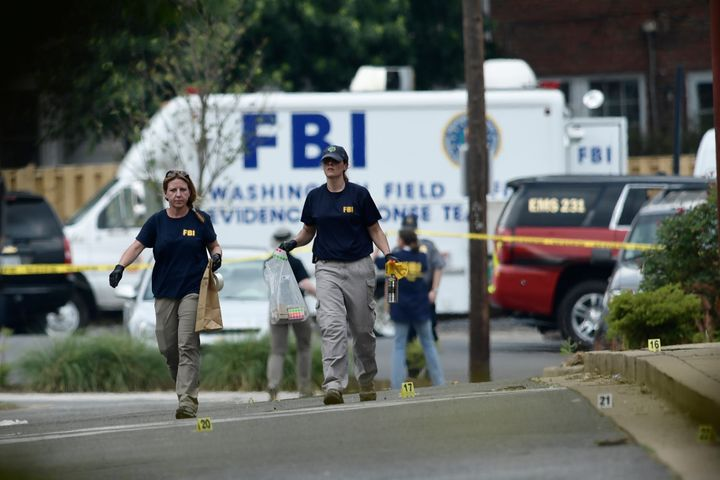 Member of the FBI inspect the crime scene after a shooting during a practice of the Republican congressional baseball at Euge