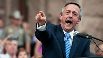 AUSTIN, TX - JULY 08: The Rev. Robert Jeffress, the controversial pastor of First Baptist Church in Dallas, energized the crowd by describing the debate over abortion as a fight 'between the kingdom of God and the kingdom of Satan,' as pro-life supporters and pro-choice protesters rally at the Texas state capitol in favor and against the new controversial abortion legislation up for a vote in the state legislature on July 8, 2013 in Austin Texas. Texas Gov. Rick Perry called on a second legislative special session to pass an restrictive abortion law through the Texas legislature. The first attempt was defeated after opponents of the law were able to stall the vote until after first special session had ended. (Photo by Erich Schlegel/Getty Images)