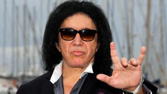 """Musician Gene Simmons of the rock band Kiss poses during a photocall for the television reality singing competition show """"Coliseum"""" during the annual MIPCOM television programme market in Cannes, October 14, 2014. REUTERS/Eric Gaillard (FRANCE - Tags: ENTERTAINMENT MEDIA HEADSHOT)"""