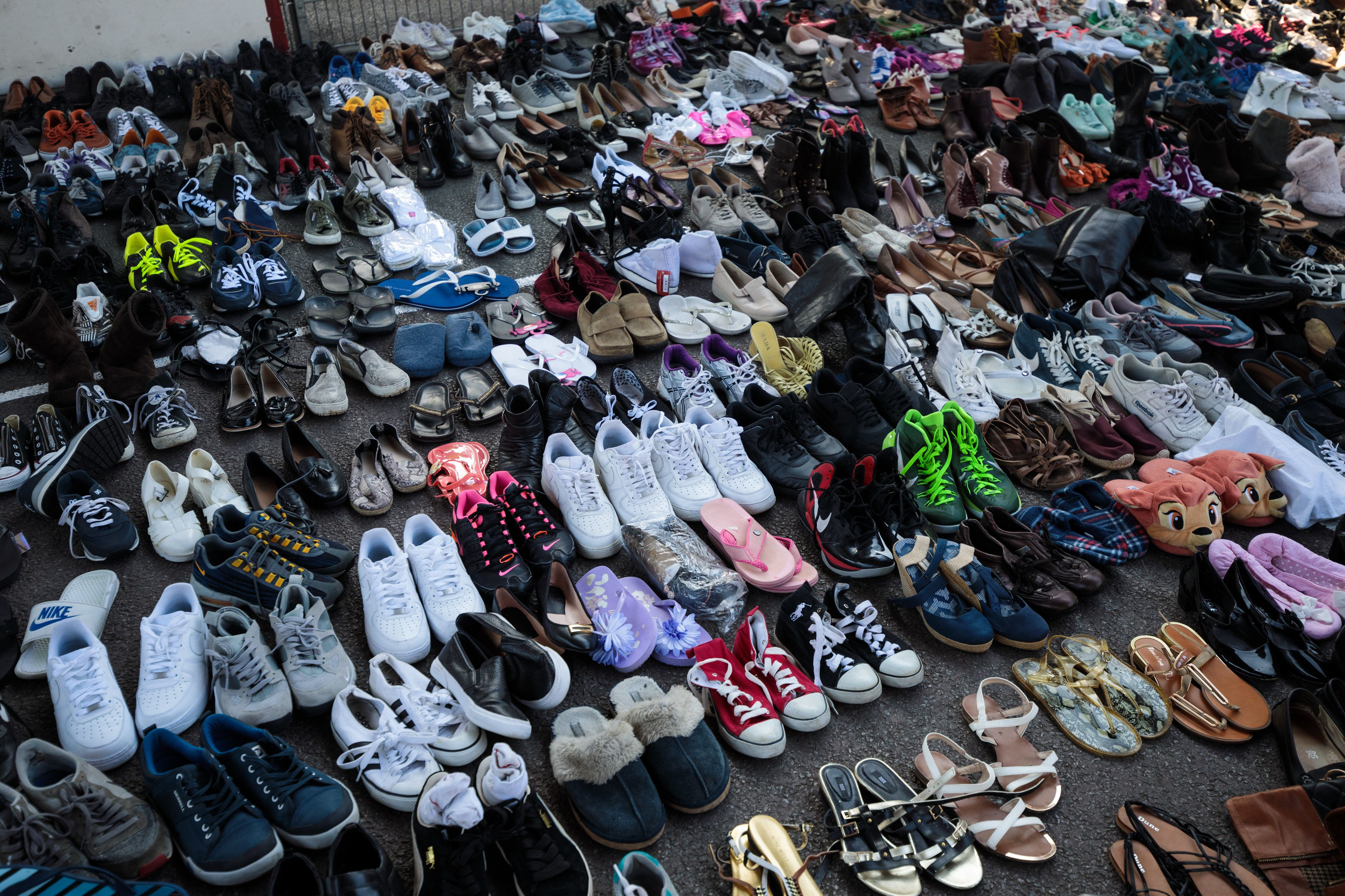 Donated shoes sit in the Westway Sports Centre near to the site of the Grenfell Tower fire on June 15,...