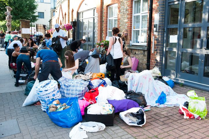 Volunteers sort through clothes donated to help the people affected