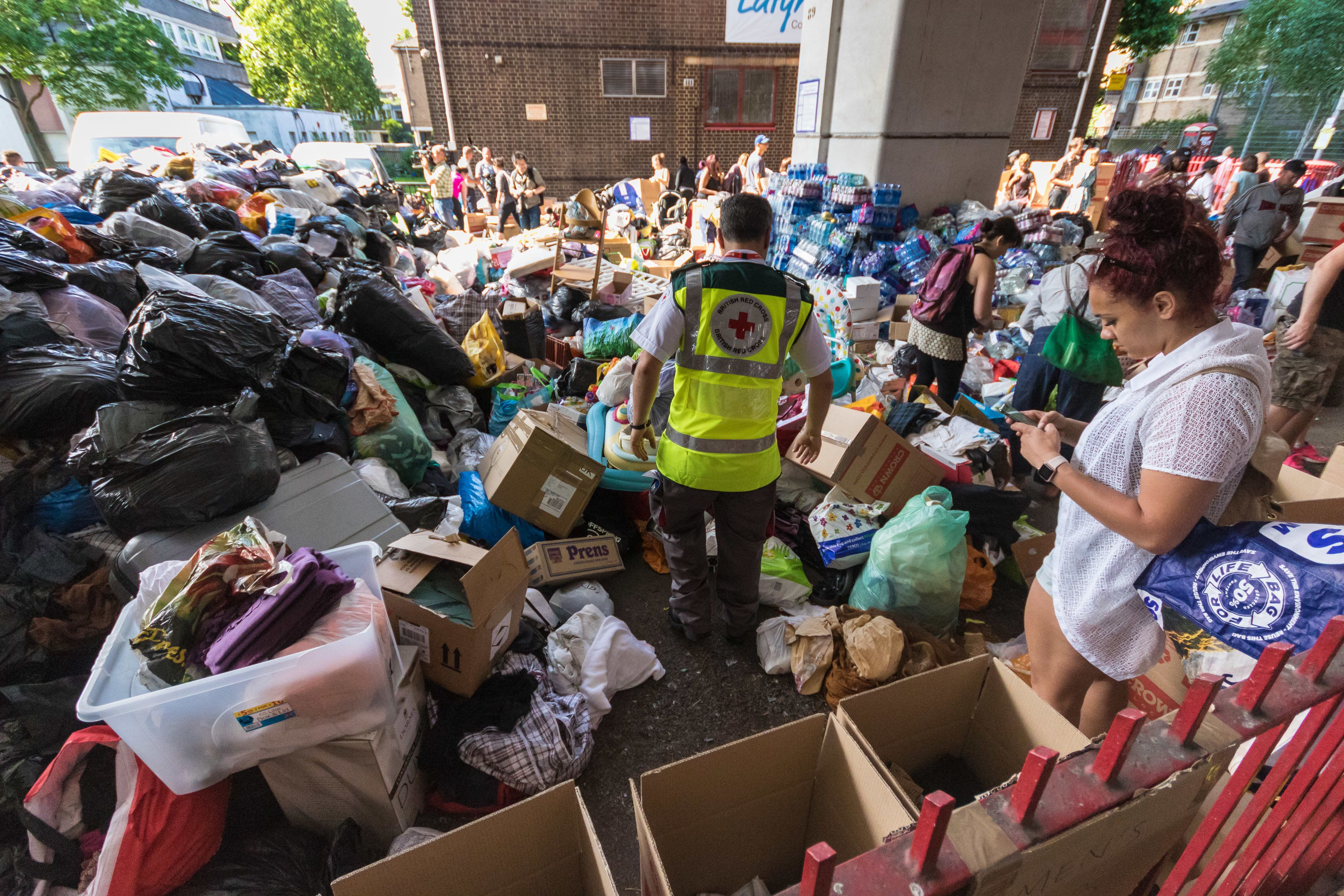 Mountains of food and clothing donated to the many people who have lost