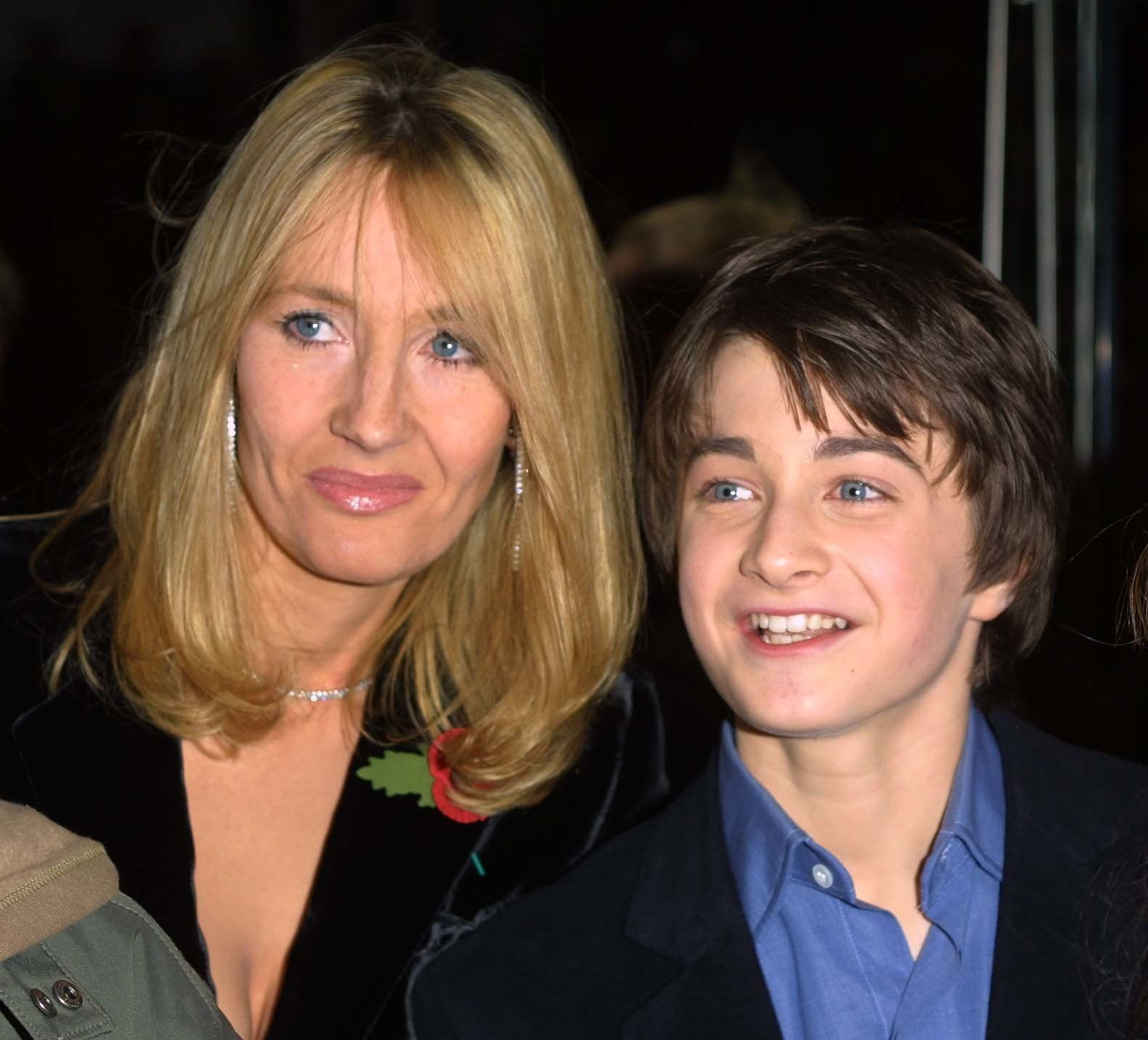 LONDON - NOVEMBER 4:  British author J.K. Rowling, creator of the Harry Potter children's books, and 11 year old Daniel Radcliffe (Harry Potter in the film version) attend the world film premiere of 'Harry Potter and The Philosopher's Stone' at the Odeon Leicester Square cinema in London on November 4, 2001. The movie is titled 'Harry Potter and The Sorcerer's Stone' for it's U.S. release. (Photo by Gareth Davies/Getty Images)