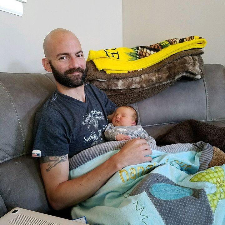 Derek Rotondo with his newborn son.