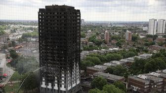 LONDON, ENGLAND - JUNE 15:  A hose continues to douse the fire at Grenfell Tower on June 15, 2017 in London, England. At least 17 people have been confirmed dead and dozens missing, after the 24 storey residential Grenfell Tower block in Latimer Road was engulfed in flames in the early hours of June 14. The number of fatalities are expected to rise.  (Photo by Dan Kitwood/Getty Images)