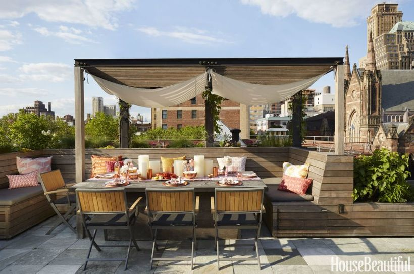 "<em>Above, warm wood tones and a pergola add an intimate feel to the rooftop patio of a</em> <a rel=""nofollow"" href=""http://w"