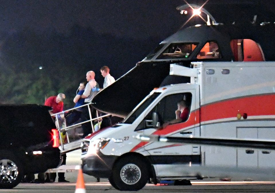 A person believed to be Otto Warmbier is transferred from a medical transport airplane to an awaiting ambulance at Lunken Air