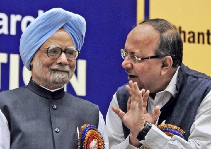 Former Indian Prime Minister Manmohan Singh with Samir Brahmachari in 2013.