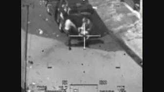 This image captured from a classified U.S. military video footage shows a wounded Iraqi person being loaded onto a van during a 2007 attack by Apache helicopters that killed a dozen people in Baghdad, including two Reuters news staff on July 12, 2007, and released to Reuters on April 5, 2010 by WikiLeaks, a group that promotes leaking to fight government and corporate corruption. Reuters photographer Namir Noor-Eldeen, 22, and his assistant and driver Saeed Chmagh, 40, were killed in the incident. The helicopter initially opens fire on the small group. Minutes later a van comes by, and starts assisting the wounded, and the helicopter opens fire on the van.  REUTERS/WikiLeaks/Handout   (IRAQ - Tags: CRIME LAW DISASTER MILITARY CIVIL UNREST) FOR EDITORIAL USE ONLY. NOT FOR SALE FOR MARKETING OR ADVERTISING CAMPAIGNS