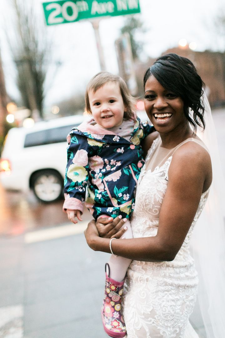 The beaming bride and her adorable fan.