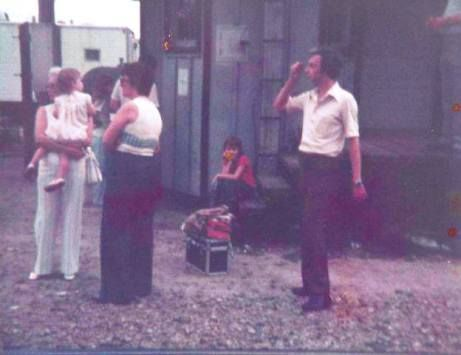 <em>One of my very young trips to see a train, in Zebulon. My grandmother is holding me on the left, Dad is on the right. He
