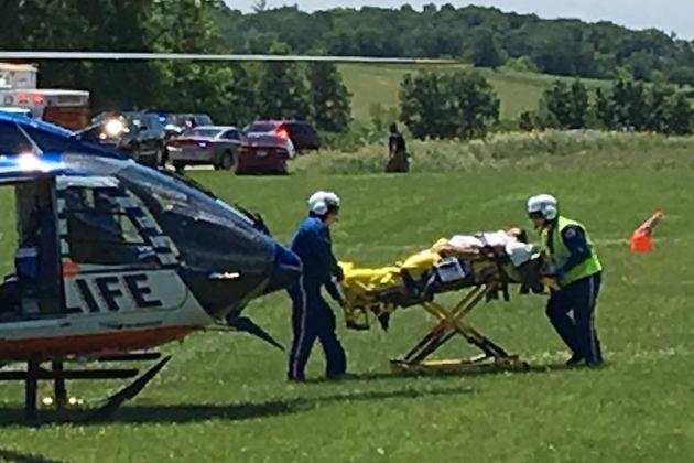 Medical personnel transport the injured