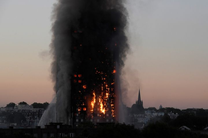Flames and smoke billow as firefighters deal with a serious fire in the Grenfell Tower apartment block at Latimer Road in Wes
