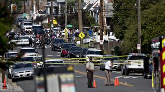 Crime scene tape lines a road near the Eugene Simpson Stadium Park in Alexandria, Virginia, U.S., on Wednesday, June 14, 2017. The third highest ranked U.S. House Republican and at least four others were injured Wednesday morning in a shooting at a congressional baseball practice field the Alexandria neighborhood witnesses said. Photographer: Andrew Harrer/Bloomberg via Getty Images