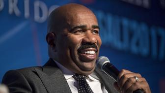 Comedian and television host Steve Harvey smiles during a Bloomberg Television interview at the Skybridge Alternatives (SALT) conference in Las Vegas, Nevada, U.S., on Thursday, May 18, 2017. The SALT Conference facilitates balanced discussions and debates on macro-economic trends, geo-political events and alternative investment opportunities for the year ahead. Photographer: David Paul Morris/Bloomberg via Getty Images