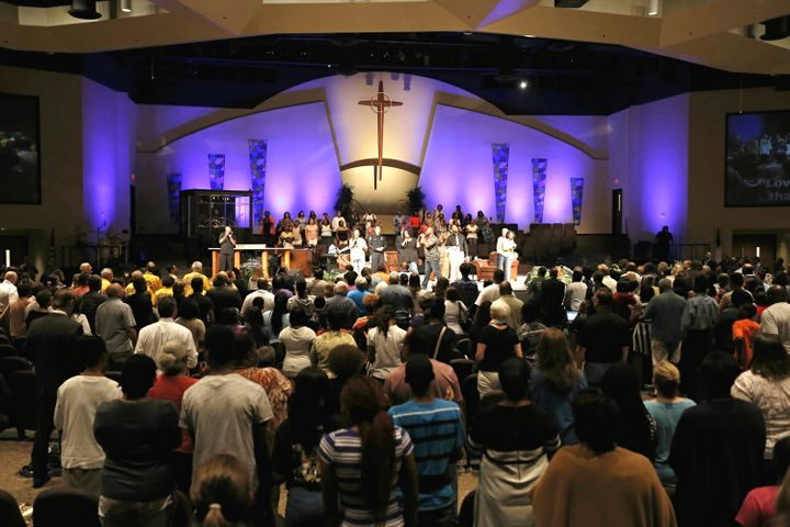 "Hundreds gather for a ""Unity, Peace and Prayer Rally"" at Cornerstone Baptist Church in Arlington, Texas, where Rev. Dwig"