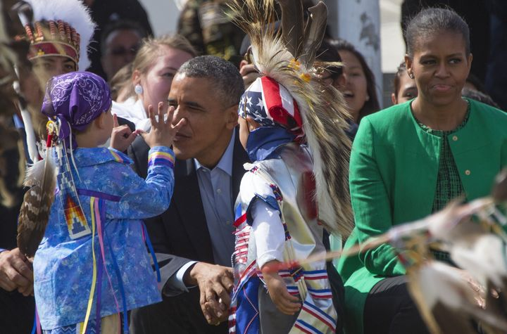 President Barack Obama talks with Native American performers during the Cannon Ball Flag Day Celebration in Cannon Ball, Nort