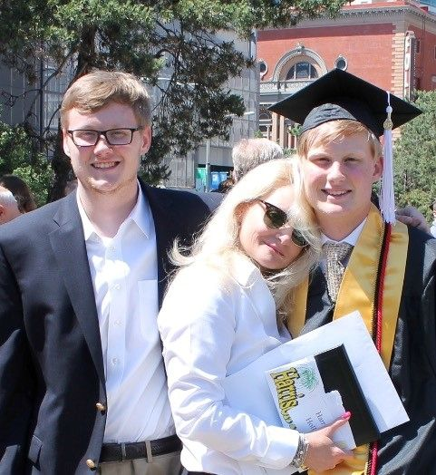 Nancy with her sons at Chance's recent high school graduation.