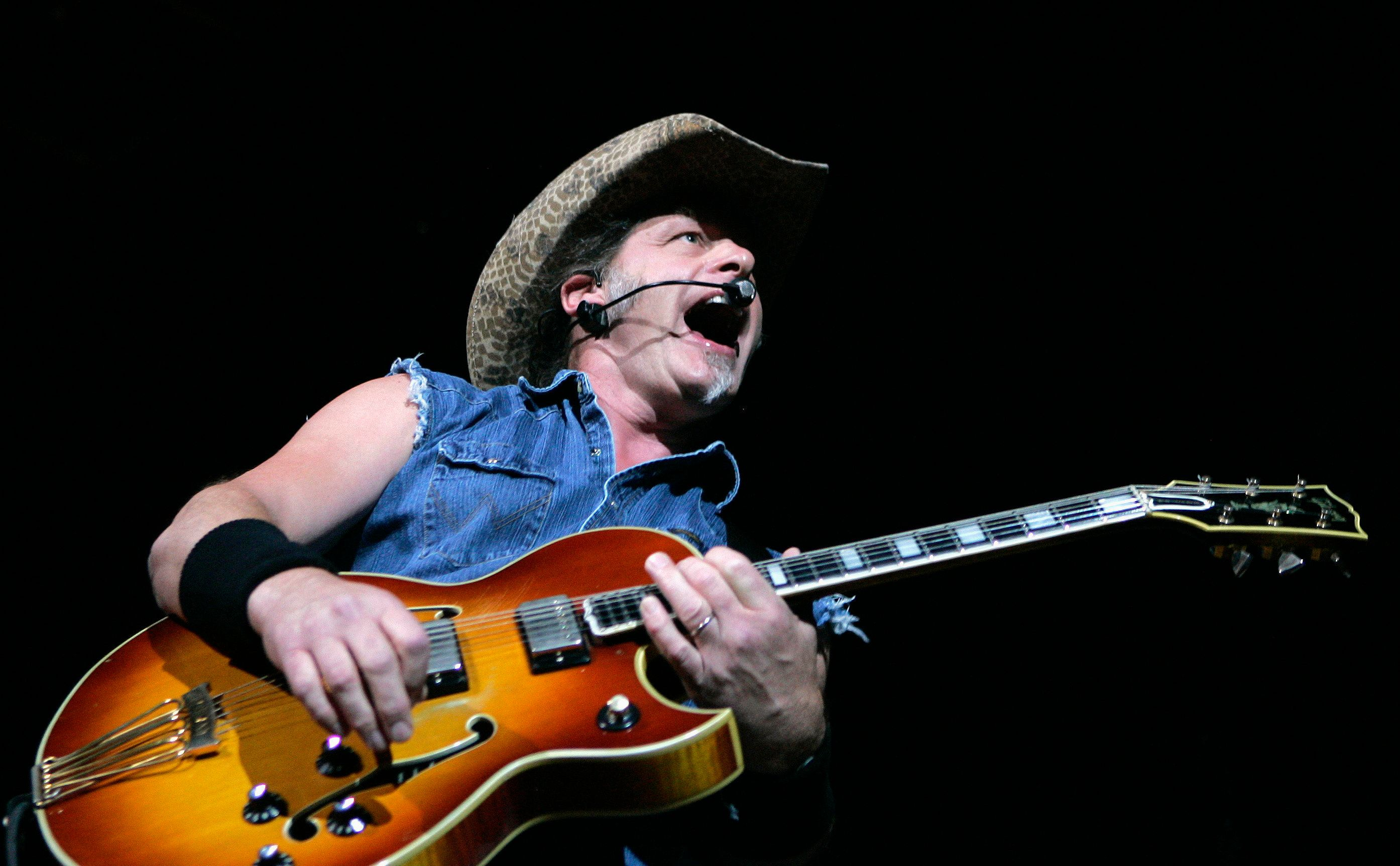 """Ted Nugent performs at a concert at the House of Blues at the Mandalay Bay Resort in Las Vegas, Nevada in this file image from August 11, 2007. Republican candidate Mitt Romney's campaign called for civility on Tuesday after aging rock star Nugent made an apparent threat against President Barack Obama before an audience of U.S. gun lobbyists. Nugent told the National Rifle Association convention in St. Louis last week that """"If Barack Obama becomes the president in November again, I will either be dead or in jail by this time next year."""" REUTERS/Steve Marcus (UNITED STATES - Tags: ENTERTAINMENT SOCIETY PROFILE POLITICS)"""