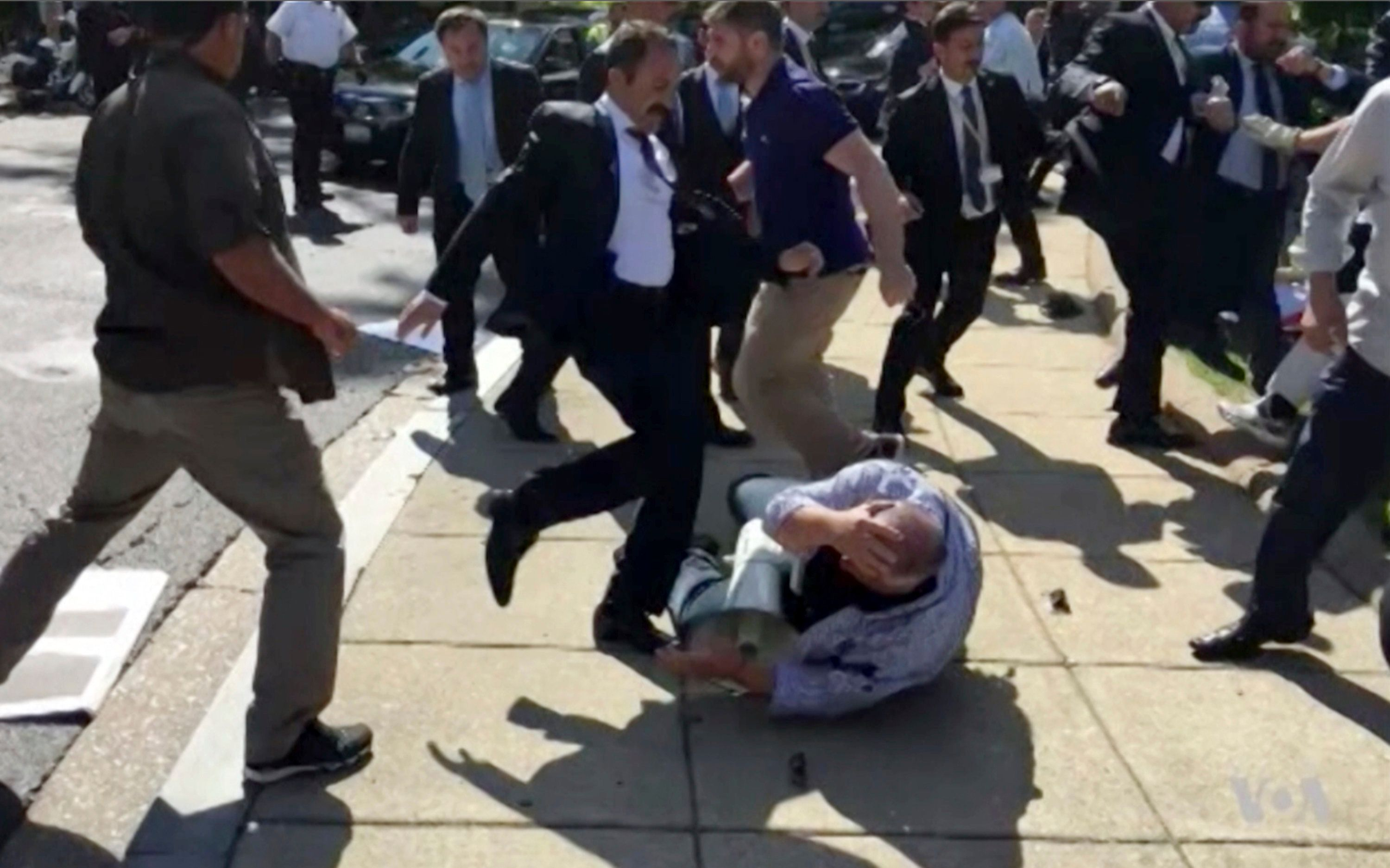 Attacker is seen kicking an American protester in the face in Washington last month