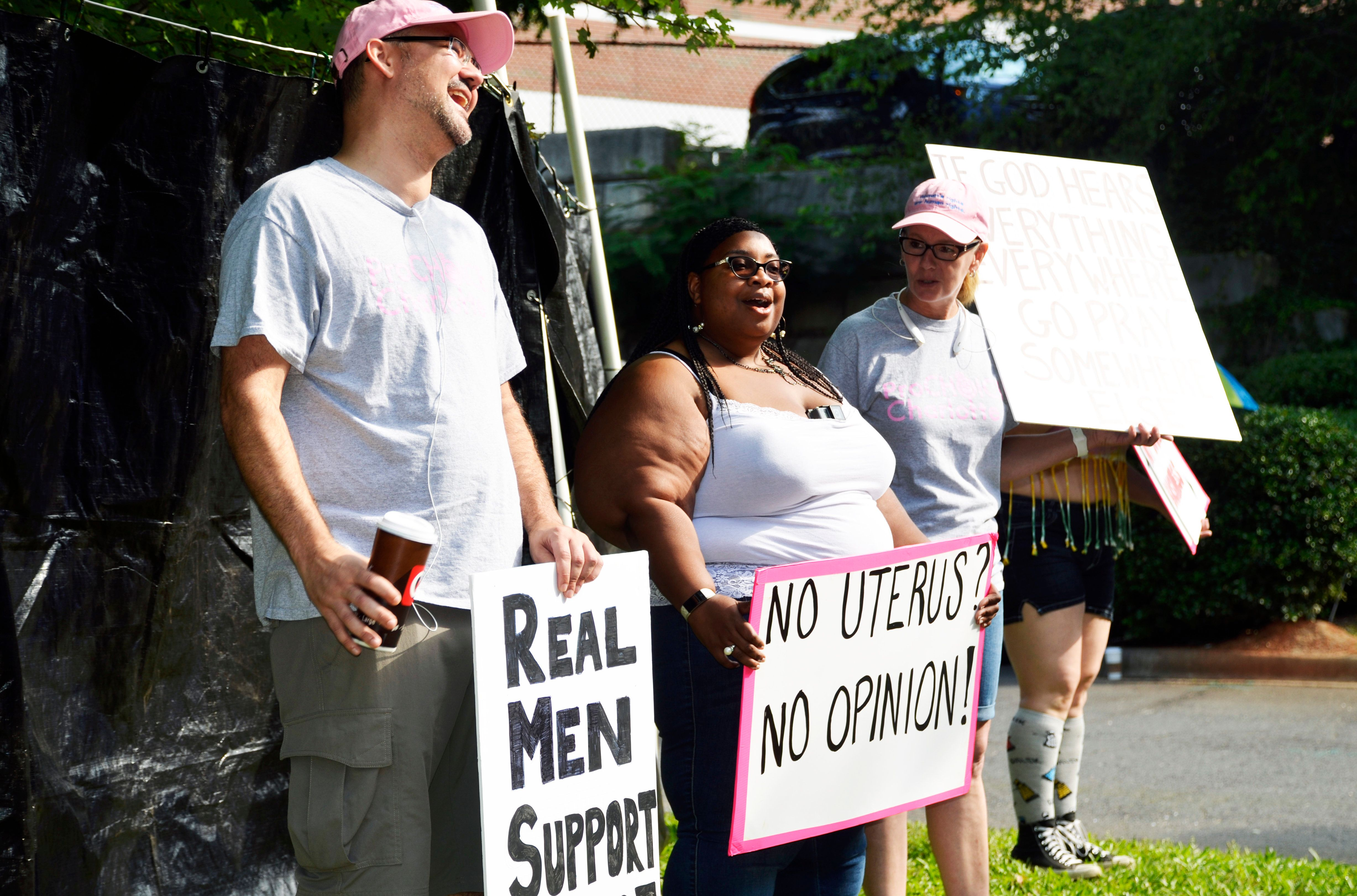 Jasmine Sherman (center) and two other members of Pro Choice Charlotte counter-protested outside A Preferred Women's Health C