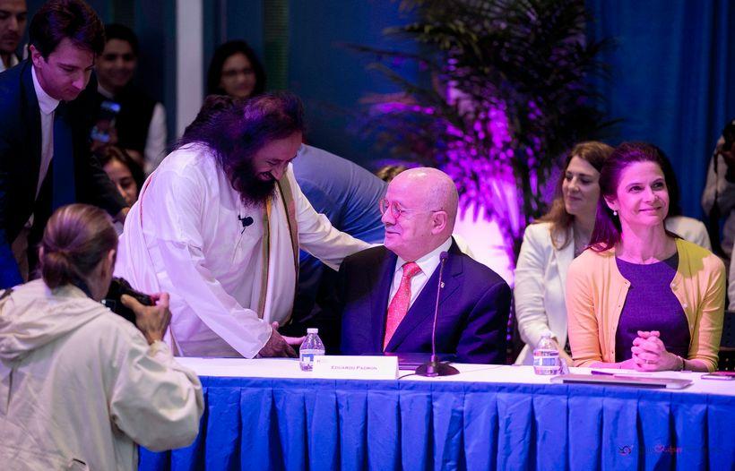 Sri Sri greeting Eduardo Padron, the President of Miami-Dade College.