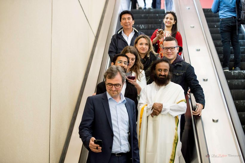 Sri Sri out for a walk after H2O discussing the many happiness projects he spearheads