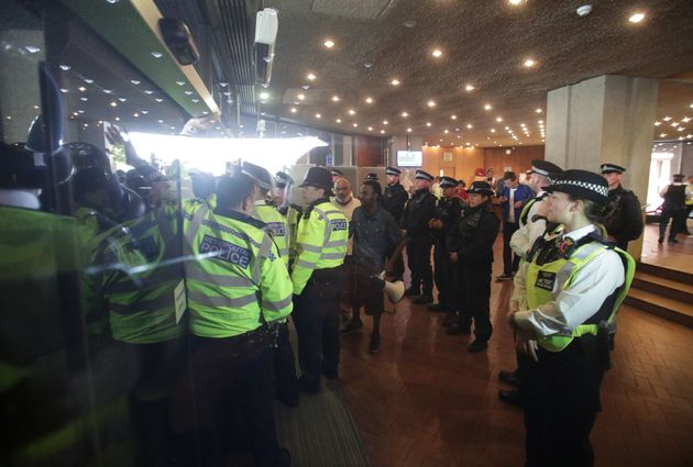 Police officers inside the building, guard against the demonstration