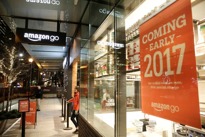 An employee outside an Amazon Go, a brick-and-mortar grocery store without lines or checkout counters, in Seattle on Dec. 5,