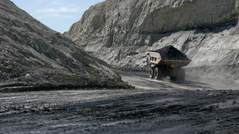 Coal is loaded into a truck at the Jim Bridger Mine, owned by energy firm PacifiCorp and the Idaho Power Company, outside Point of the Rocks, Wyoming March 14, 2014. West Virginia mined 120 million tons (109 metric tons) of coal in 2012, second to Wyoming, or about 12 percent of total U.S. production. Kentucky was third with about 9 percent of output, according to the National Mining Association.  REUTERS/Jim Urquhart  (UNITED STATES - Tags: ENERGY BUSINESS)