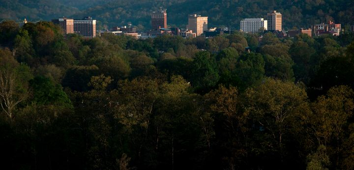 The once economically strong industrial city of Huntington, sometimes described as the epicenter of the opioid crisis, is seen nestled in trees along the Ohio River on April 20, 2017 in West Virginia.
