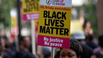 "A supporter of the UK branch of ""Black Lives Matter"" takes part in a demonstration in London, Britain August 5, 2016.  REUTERS/Peter Nicholls"