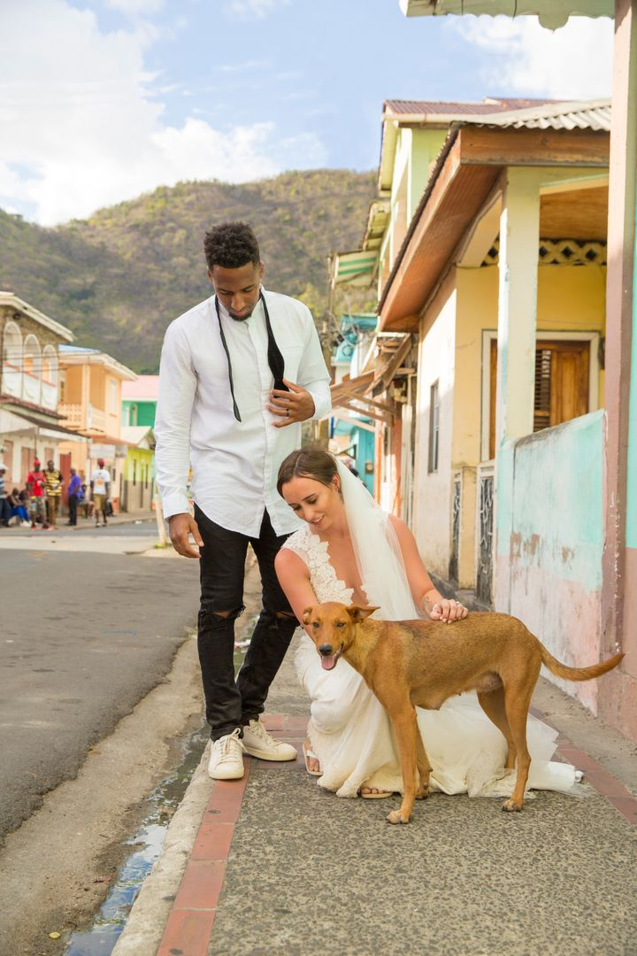 This stray pup, who has since been rescued by HelpAWS, took a liking to the couple and started following them around during their photo shoot.