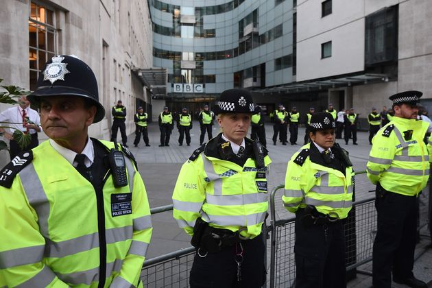 Police Officers stand guard outside Broadcasting