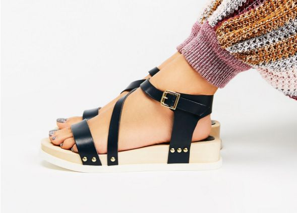 "Buy the <a href=""https://www.freepeople.com/shop/sundown-flatform-sandal/"" target=""_blank"">Free People 'Sundown Flatform' </a"