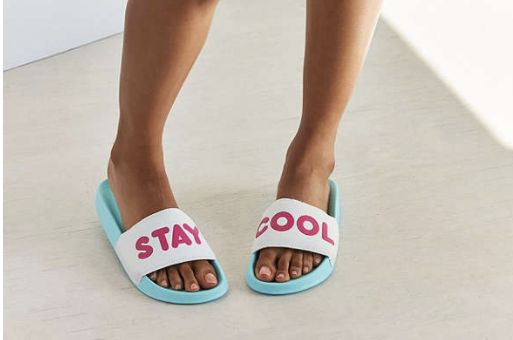 "Buy the <a href=""https://www.urbanoutfitters.com/shop/stay-cool-pool-slide?category=womens-sandals&color=046"" target=""_bl"