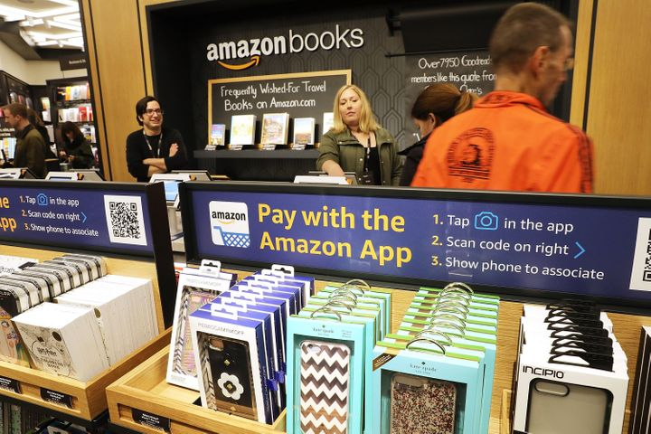 People shop in the newly opened Amazon Books on May 25 in New York City. Amazon Books, like the Amazon Go store, does not acc