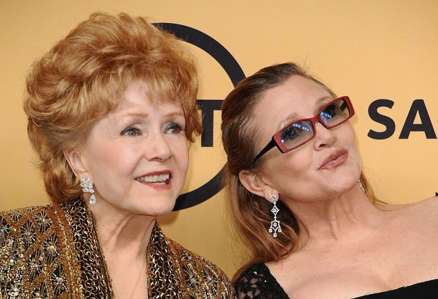 Actress Debbie Reynolds poses with her daughter, actress Carrie Fisher, in the press room at the...