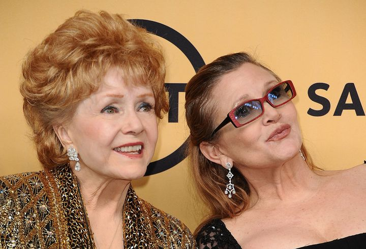 Actress Debbie Reynolds poses with her daughter, actressCarrie Fisher, in the press room at the Screen Actors Guild Awa