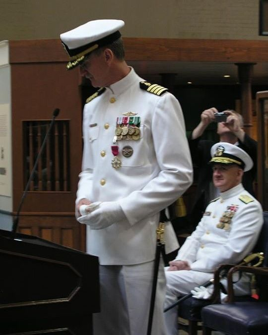 My father (standing, with saber) at his retirement ceremony.
