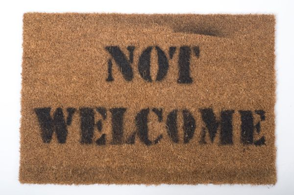 A young refugee from Eritrea, who nows lives in southeast England, created this doormat to symbolize how asylum seekers and r