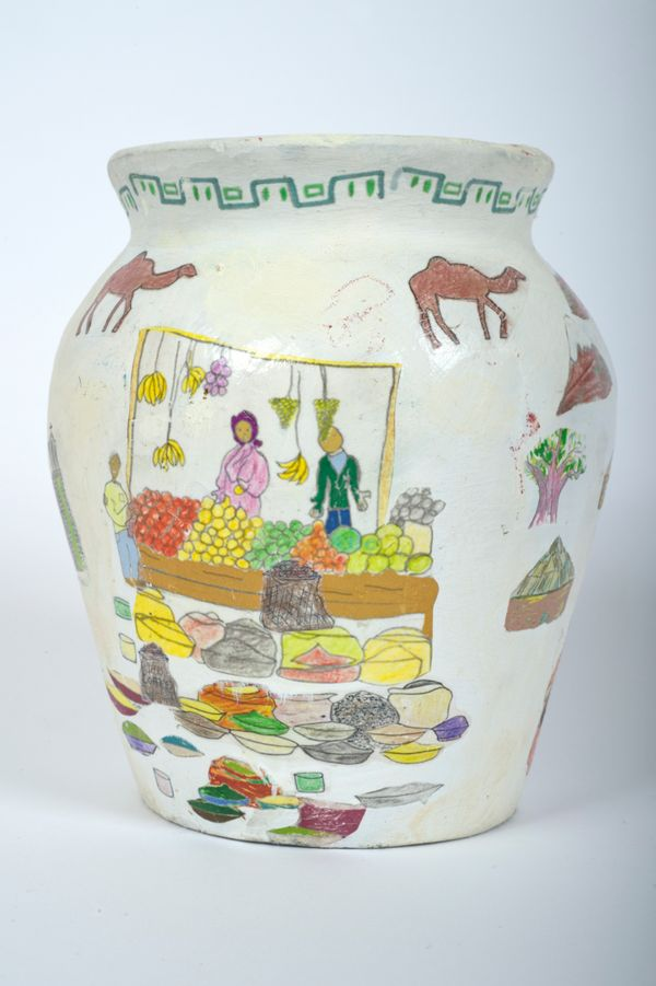 Four young refugees from Eritrea created this vase, which features their memories of home.