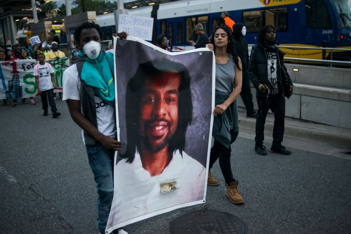 Protesters carry a portrait of Philando Castile on June 16, 2017 in St Paul, Minnesota.
