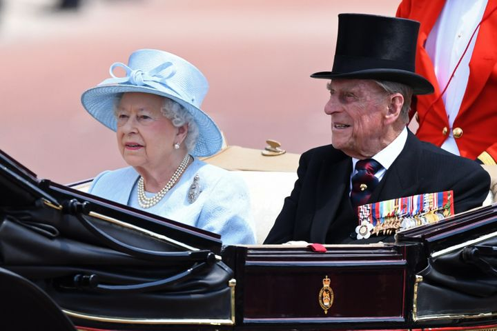 The queen and Prince Philip arriving.