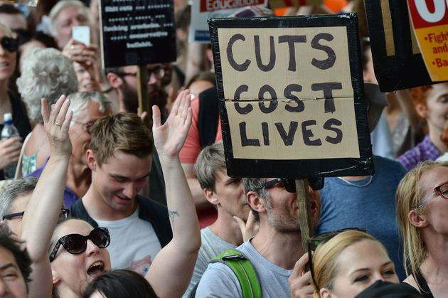 Demonstrators hold placards and chant during an anti-Conservative Party Leader and Britain's Prime Minister...