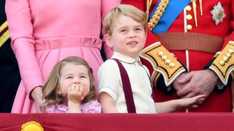 LONDON, ENGLAND - JUNE 17:  Princess Charlotte of Cambridge and Prince George of Cambridge look on from the balcony during the annual Trooping The Colour parade at the Mall on June 17, 2017 in London, England.  (Photo by Karwai Tang/WireImage)